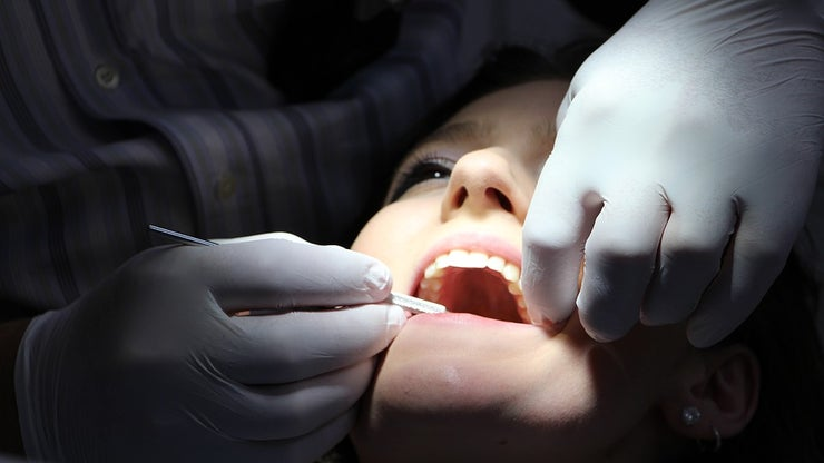 Woman having teeth examined by a dentist