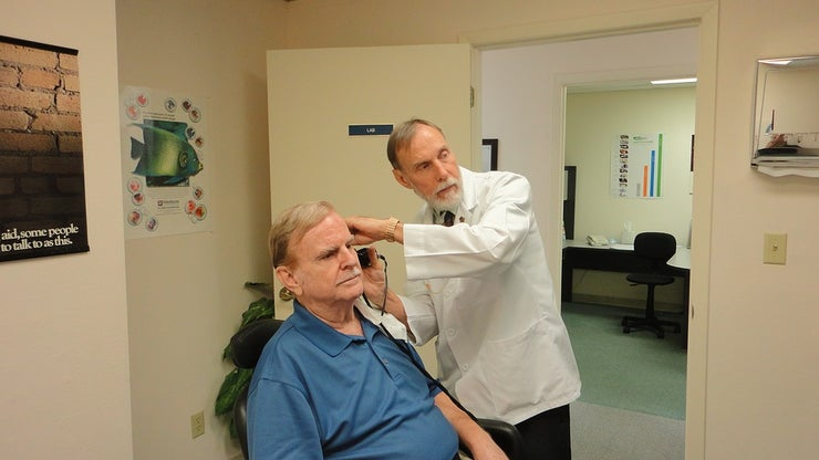 Man having hearing tested by doctor
