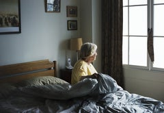 Older adult sitting in bed.